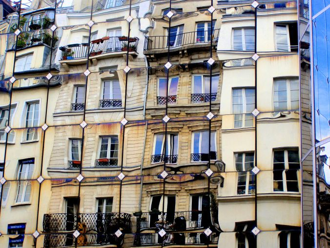 An Enigmatic Reflection. This faceless building, clad in reflective panels, reflects its older, residential, counterpart in Rue Rambuteau, 75004 Paris. The contemporary reflects the traditional. https://witness.theguardian.com/assignment/552e3c5be4b0dfcbad6c3d9f/1477750