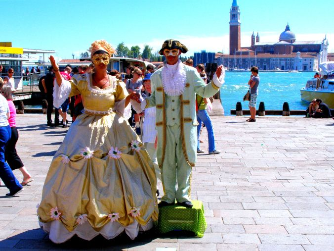 Ready for the Masked Carnival in Venice ... or the Carnevale Maschera di Venezia, to name it correctly. I couldn't be sure whether or not she too was standing on a box or was almost eight feet tall after all. https://witness.theguardian.com/assignment/554264b5e4b07879681b8c09/1509933