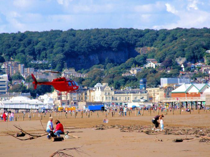 An Attention Seeker Hovering Around The Beach. A colourful moment at Weston-Super-Mare. https://witness.theguardian.com/assignment/55afb147e4b0571ff3516306/1652721