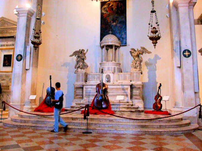 Music – A Question Of Timing. This man looks as though he's instrumental in the theft of a cello from the Museo della Musica in the restored neoclassical Chiesa di San Maurizio, S. Marco 2603 30124 Venezia. In fact, he's this side of the rope barrier and the cello is firmly placed on the red display stand. The Museo also hosts an exhibition dedicated to the life and the work of Antonio Vivaldi, the world renowned Venetian composer. https://witness.theguardian.com/assignment/559d15cce4b032a39a3bb39a/1651286