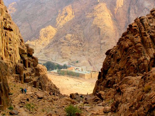 "Approaching Saint Catherine's Monastery, South Sinai Governorate, Egypt ""James, stop photographing rocks and keep up!"" The monastery was built between 548 and 565 and is one of the oldest working Christian monasteries in the world. Housing the world's oldest continually operating library it possesses the Syriac Sinaiticus, a late 4th-century manuscript of 358 pages which contains a translation of the four canonical gospels of the New Testament into Syriac. Until 1859, it also housed the Codex Sinaiticus or ""Sinai Bible"" which is an ancient, handwritten copy of the Greek Bible, most of which is now held in the British Library, London. https://witness.theguardian.com/assignment/5645b219e4b04096fed8b8dd/1805765"